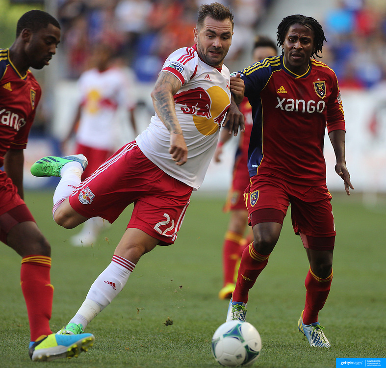 Lovel Palmer, Real Salt Lake and Jonny Steele, New York Red Bulls, challenge for the ball during the New York Red Bulls V Real Salt Lake, Major League Soccer regular season match at Red Bull Arena, Harrison, New Jersey. USA. 27th July 2013. Photo Tim Clayton