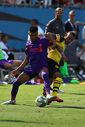 July 22, 2018 - Charlotte, NC, U.S. - CHARLOTTE, NC - JULY 22: Dominic Solanke (29) of Liverpool and Herbert Bockhorn (39) of Borussia Dortmund fight for control of the ball during the International Champions Cup soccer match between Liverpool FC and Borussia Dortmund in Charlotte, N.C. on July 22, 2018. (Photo by John Byrum/Icon Sportswire) (Credit Image: © John Byrum/Icon SMI via ZUMA Press)