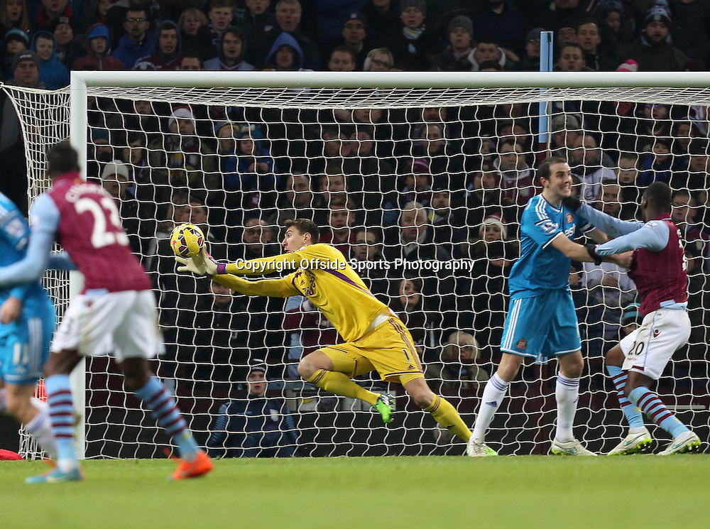 28th December 2014 - Barclays Premier League - Aston Villa v Sunderland - Sunderland keeper Costel Pantilimon makes a diving save from a Christian Benteke of Aston Villa shot - Photo: Paul Roberts / Offside.