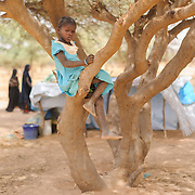 "Samsia Madou (8), at a refugee camp in Mangaize in the Tillaberi region of Niger on 1 March 2012, says her family fled to Niger ""because the soldiers came."""
