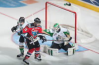 KELOWNA, CANADA - DECEMBER 6: Tyrell Goulbourne #12 of Kelowna Rockets attempts to score a goal while being stick checked by Brendan Guhle #4 in front of Nick McBride #40 of Prince Albert Raiders on December 6, 2014 at Prospera Place in Kelowna, British Columbia, Canada.  (Photo by Marissa Baecker/Shoot the Breeze)  *** Local Caption *** Tyrell Goulbourne; Brendan Guhle; Nick McBride;