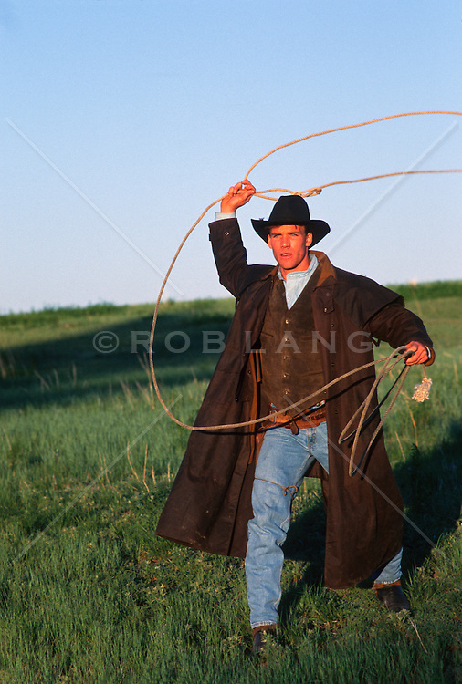 Cowboy using a lasso in a field on a ranch in New Mexico