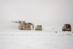 ©London News Picures. Gritting teams at Gatwick airport runway after havy snow forced all fligs grounded, Airport is closed and all flights are canceled untill Thursday morining  due to havy snow on December 1st. Photo credit should read Fuat Akyuz/London News Pictures