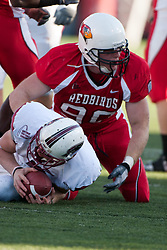 14 October 2006: Dan Simnick tackles Justin Allen. The 6th largest crowd at Hancock Stadium came to watch a game that put 8th ranked Southern Illinois Salukis against 5th ranked Illinois State University Redbirds.  The Redbirds stole the show for a Homecoming win by a score of 37 - 10. Competition commenced at Hancock Stadium on the campus of Illinois State University in Normal Illinois.<br />