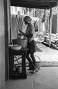 Girl washing clothes - Port Antonio