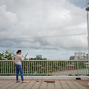 NOVEMBER , 2017&ndash;SAN JUAN, PUERTO RICO&mdash;<br /> Omaya Sosa Pascual from the Centro de Periodismo Investigativo tries out a  satellite phone received from NAHJ members  donated in an effort to help local journalists  better cover their communities. <br /> (Photo by Angel Valentin)