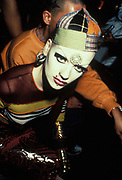 Polly, a woman with extreme make-up and piercings, Clubbing 1990's