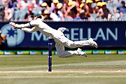 Nathan Lyon dives to save runs during the Magellan fourth test match between Australia v England at  the Melbourne Cricket Ground, Melbourne, Australia on 26 December 2017. Photo by Mark  Witte.