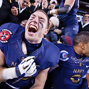 Navy Running Back John Howell #33 screams while celebrating with his Navy teammates and fans after Navy defeated Army 27-21 Saturday, Dec. 10, 2011 at Fed EX field in Landover Md.<br /> <br /> Navy set the tone in the fourth quarter while Army mistake cost them the game,  Navy defeats Army 27-21 in front of 82,000 at Fed EX Field in Landover Md.