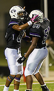 Cedar Ridge's Terrell Scales (53) congratulates running back Raymond Racine (81) after Racine's fourth quarter touchdown against MacArthur at Kelly Reeves Athletic Complex Friday night.  Cedar Ridge beat MacArthur 58-57 in double overtime,