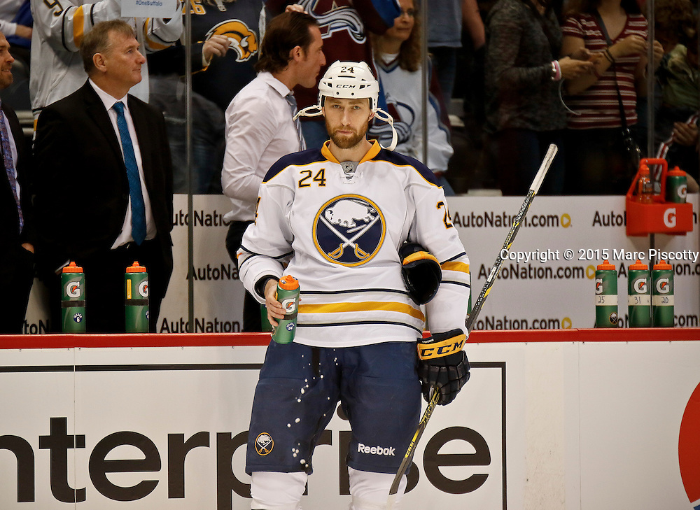 SHOT 3/28/15 6:33:31 PM - The Buffalo Sabres' Tyson Strachan #24 grabs a drink of water during warmups before their regular season NHL game against the Colorado Avalanche at the Pepsi Center in Denver, Co. The Avalanche won the game 5-3. (Photo by Marc Piscotty / © 2015)