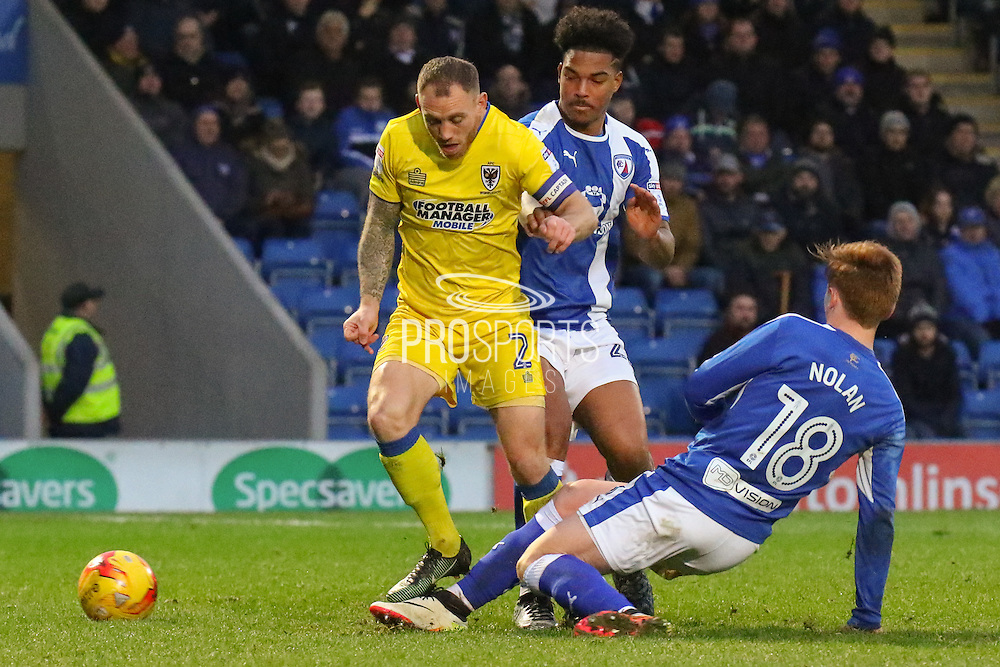 AFC Wimbledon defender Barry Fuller under pressure during the EFL Sky Bet League 1 match between Chesterfield and AFC Wimbledon at the Proact stadium, Chesterfield, England on 21 January 2017. Photo by Aaron  Lupton.