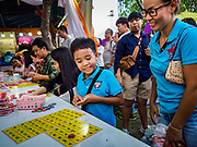 24 NOVEMBER 2018 - BANGKOK, THAILAND:  People play a game of Thai Bingo at the Red Cross Fair. The Red Cross Fair is a fund raiser and annual event in Bangkok that draws thousands of attendees every night of its nine day run. The fair features games of chance, a midway with rides, handicrafts and food. This is the first year the fair has been in Lumpini Park. Previously it had been held in the Dusit section of Bangkok. The 2018 Fair marks 125 years of service for the Red Cross in Thailand.   PHOTO BY JACK KURTZ