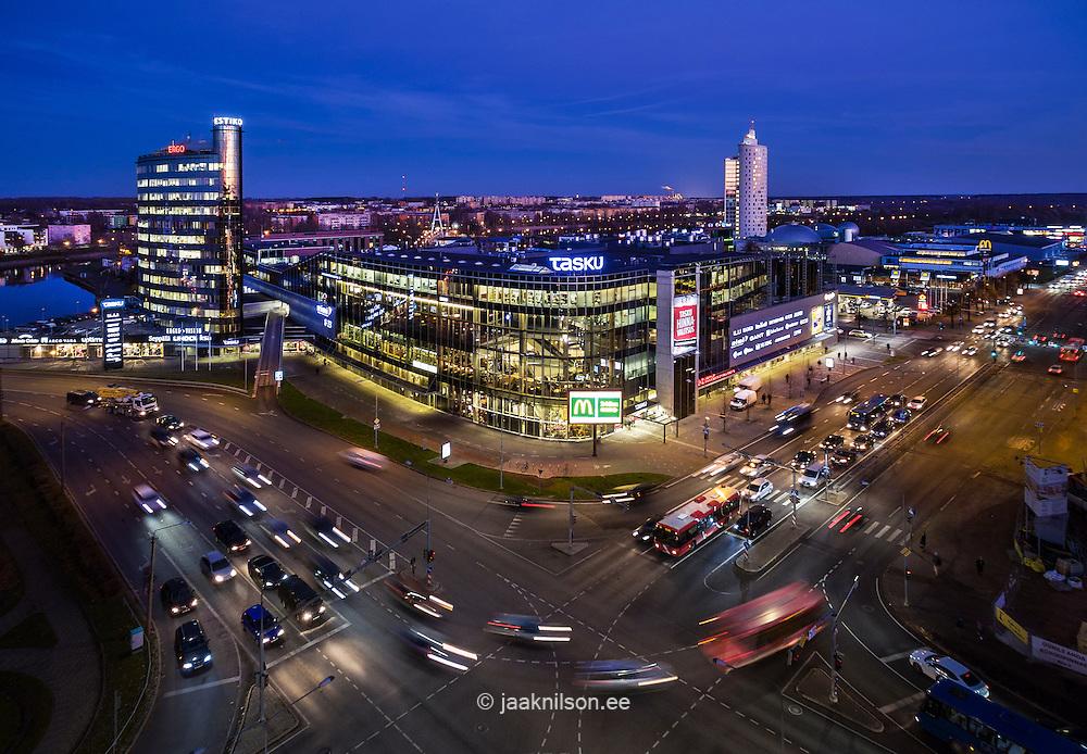 Tartu in night, Estonia. Aerial, lighted modern buildings. Street, cars, traffic. Twilight.