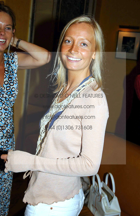 MISS MARTHA WARD at a party to celebrate the launch of Michelle Watches held at the Blue Bar, The Berkeley Hotel, London on 7th October 2004.<br /><br />NON EXCLUSIVE - WORLD RIGHTS
