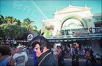 Fantasy fest on the streets of Key West. Man dressed up as Elvis on the main street of Key West.