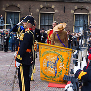 NLD/Den Haag/20130917 -  Prinsjesdag 2013, Koning Willem Alexander en Koningin Maxima groeten het vaandel