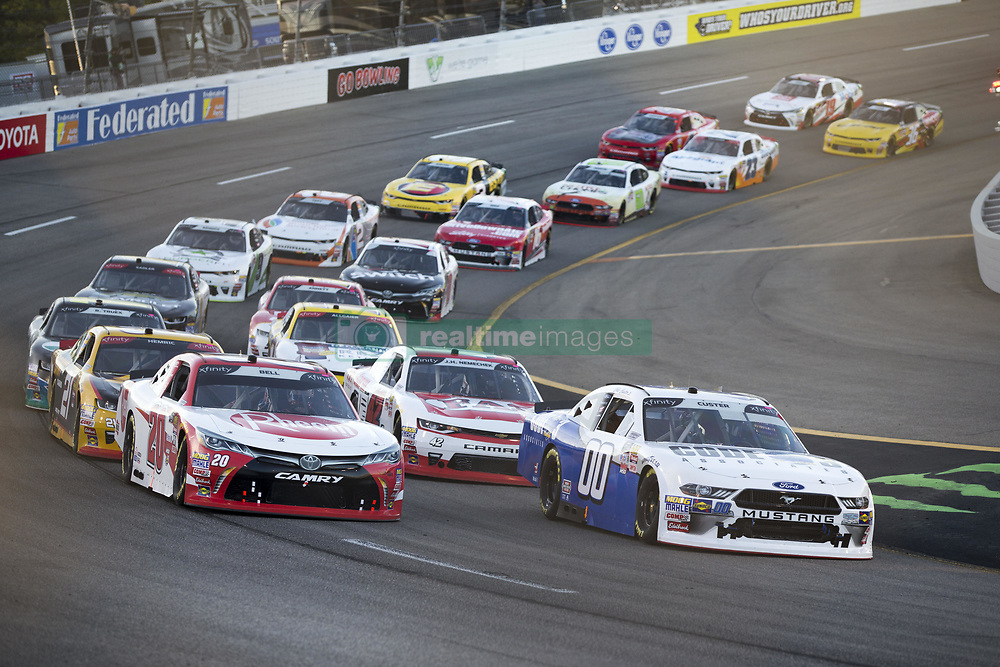 April 21, 2018 - Richmond, Virginia, United States of America - April 20, 2018 - Richmond, Virginia, USA: Cole Custer (00) and Christopher Bell (20) lead the field off turn four during the ToyotaCare 250 at Richmond Raceway in Richmond, Virginia. (Credit Image: © Stephen A. Arce/ASP via ZUMA Wire)