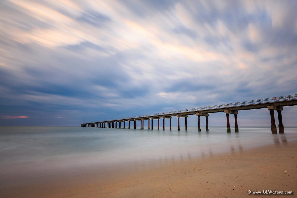 Moving clouds and surf during a long exposure at the Duck Research Pier.