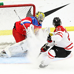 COBOURG, - Dec 19, 2015 -  Gold Metal Game - Russia vs Canada West at the 2015 World Junior A Challenge at the Cobourg Community Centre, ON. Noah Bauld #23 of Team Canada West drives to the net during the third period. (Photo: Tim Bates / OJHL Images)