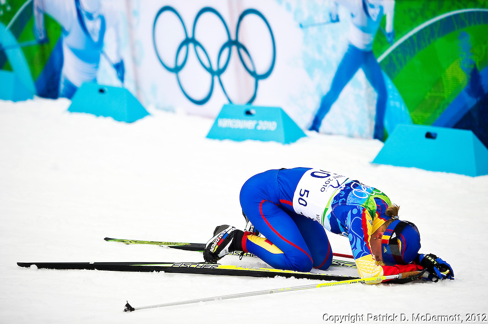 Monika Gyorgy of Romania collapses after the ladies' 30 km mass start cross-country skiing classic on day 16 of the 2010 Vancouver Winter Olympics at Whistler Olympic Park Cross-Country Stadium on February 27, 2010 in Whistler, Canada. dd