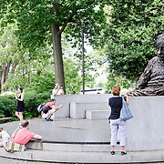 Tourists snap photos of the Einstein Memorial, features a 21-foot bronze statue by famed sculpture Robert Berks, sits in the southwest corner of the grounds of the National Academy of Sciences along Constitution Avenue.
