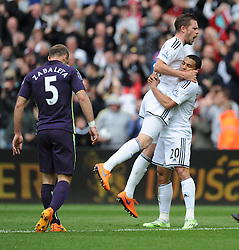 Swansea City's Gylfi Sigurosson celebrates with Swansea City's Jefferson Montero - Photo mandatory by-line: Alex James/JMP - Mobile: 07966 386802 - 17/05/2015 - SPORT - Football - Swansea - The Liberty stadium - Swansea City v Manchester City - Barclays premier league