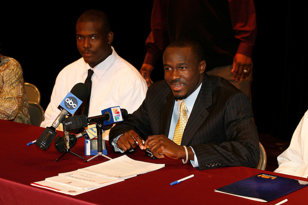 Glades Central High School wide receiver Deonte Thompson sits with teammate Jatavious Jackson before signing his National Letter of Intent with the University of Florida on February 7, 2007 at Glades Central High School in Belle Glade, Florida. Jackson signed with Florida State University.