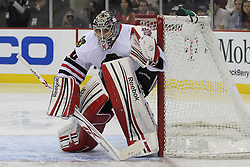Mar 27; Newark, NJ, USA; Chicago Blackhawks goalie Corey Crawford (50) defends the net during the second period of their game against the New Jersey Devils at the Prudential Center.