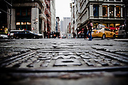 Close view on a manhole in the streets of SoHo, Manhattan, New York, 2009.