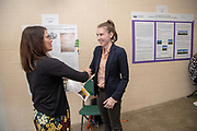 "Laura Bennett is awarded  the Undergraduate Award from Janet Hulm, Interim Dean of University Libraries for her work titled, ""Tolerating the Dissenters: A comparison of the Toleration Acts enacted in the 17th and 18th Century Great Britain and Ireland""  at the Student Expo.  Bennett's project titled, Photo by Ben Siegel"