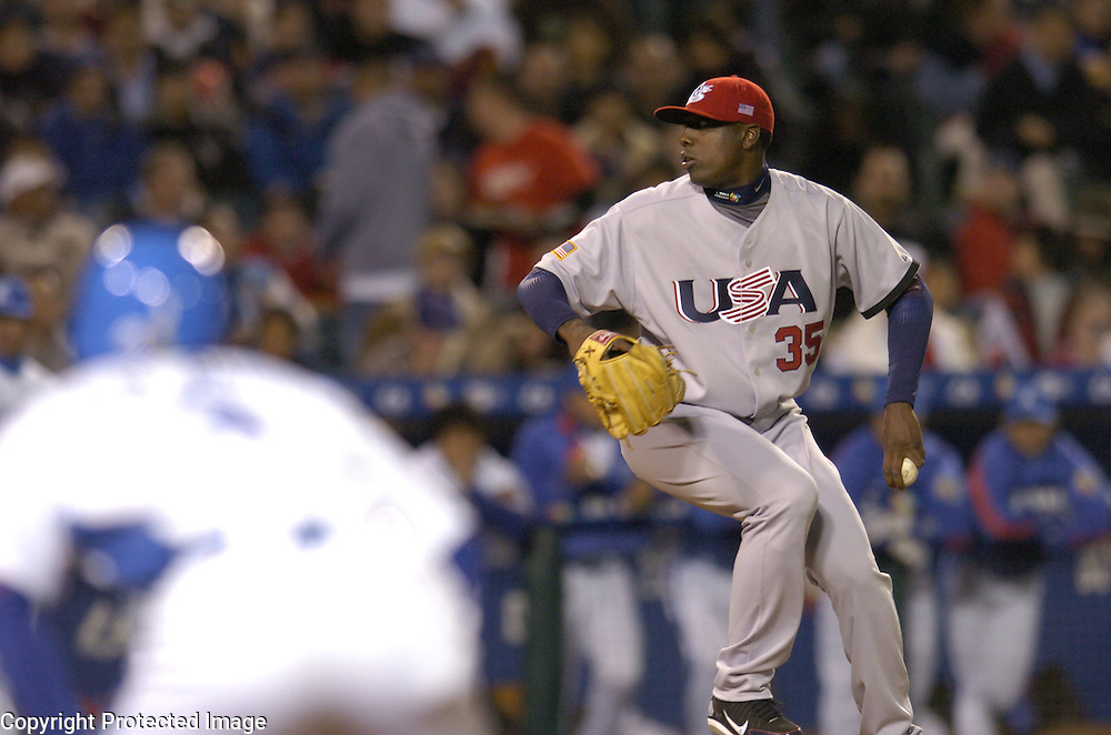 Team USA starter Dontrelle Willis throws a pitch in the 2nd inning with Team Korea's Jin Man Park on 1st base in Round 2 action at Angel Stadium of Anaheim.