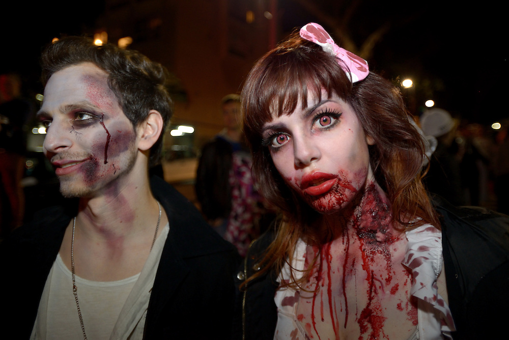 TEL AVIV, ISRAEL - MAR 15, 2014: An Israeli couple wearing zombie make-up and costumes participate the Zombie Walk during the Purim festival in Tel Aviv. The Zombie Walk is held in tel Aviv during Purim Holiday in which Jewish traditionaly wear costumes. Photo by Gili Yaari