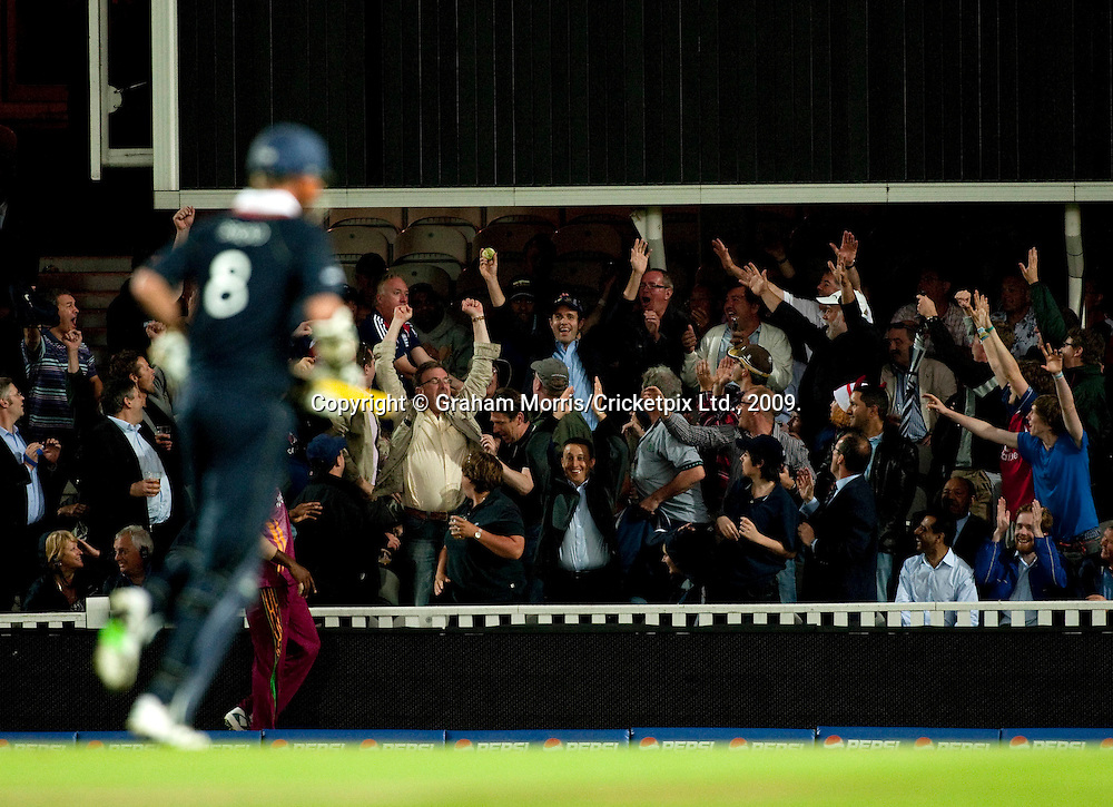 Stuart Broad hits a six into the pavilion off the last ball of the innings in the ICC World Twenty20 Cup match between West Indies and England at The Oval. Photo © Graham Morris (Tel: +44(0)20 8969 4192 Email: sales@cricketpix.com)