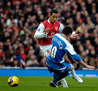 Photo: Ed Godden/Sportsbeat Images.<br /> Arsenal v Wigan Athletic. The Barclays Premiership. 11/02/2007. Arsenal's Theo Walcott (L), is tackled by Lee McCulloch.
