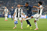 Manchester United Forward Anthony Martial attacks the goal and battles with Juventus Forward Juan Cuadrado during the Champions League Group H match between Juventus FC and Manchester United at the Allianz Stadium, Turin, Italy on 7 November 2018.