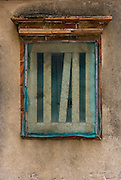 Close up of old window on Kinmen, Republic of China ROC (Taiwan). ...Kinmen (Jinmen) formely known as Quemoy. The island lies less than 2km off the coast of China, and in 1949 was turned into a front-line of defense for Taiwan by Chiang Kai-shek and the Chinese nationalist Kuomintang (KMT) in the ongoing war with the communist PRC. The island existed under martial law until 1993. Today, Kinmen is a popular tourist destination and home to a lot of traditional Fujian-style architecture.