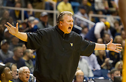 Jan 12, 2016; Morgantown, WV, USA; West Virginia Mountaineers head coach Bob Huggins argues with a referee during the first half at the WVU Coliseum. Mandatory Credit: Ben Queen-USA TODAY Sports