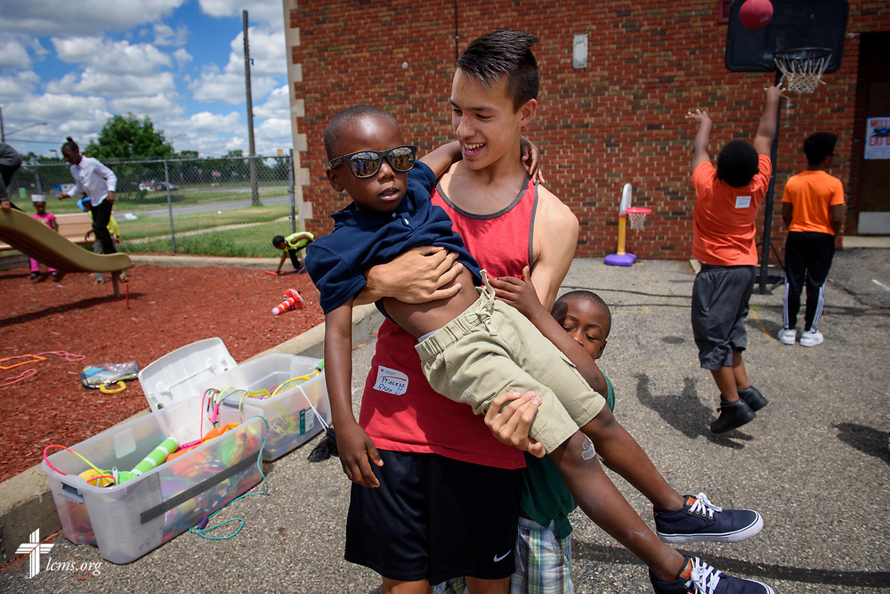 Ryan Boos carries Chase Claybrooks while his brother Chance holds on during recreation time at vacation Bible camp at East Bethlehem Lutheran Church, Detroit, Mich., on Wednesday, June 21, 2017, in Detroit. LCMS Communications/Erik M. Lunsford