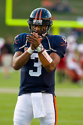 Virginia quarterback Riko Smalls (3) warms up before the UMD game.  The Virginia Cavaliers defeated the Maryland Terrapins 31-0 in NCAA football at Scott Stadium on the Grounds of the University of Virginia in Charlottesville, VA on October 4, 2008.