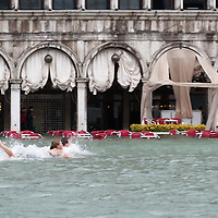Extreme High tide in Venice with more than 150cm recorded. The day started with emergency services stretched for the number of calls but also damages for the shops at the same time tourists in particular  tried not to take it too seriously, even swimming in St Mark's Square Copyright by Marco Secchi.http://www.marcosecchi.com.email msecchi@gmail.com