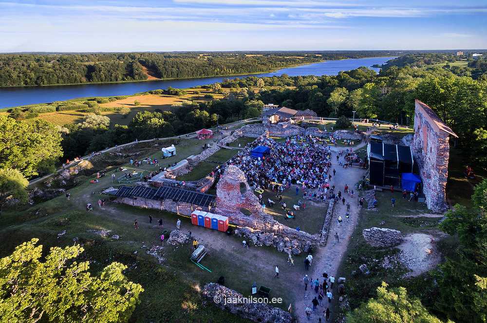 Folk music festival in Viljandi bishop castle, Estonia. Aerial view, lake, ruins and walls. Public, stage.