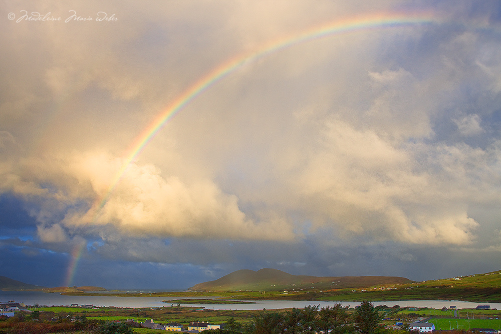 Sunrise with rainbow over Cahersiveen and Begenish Island with stormy Sky, County Kerry, Ireland / rb019
