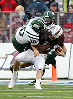 Louisiana-Monroe quarterback Kolton Browning (15) is sacked by Ohio defensive lineman Tremayne Scott (90) during the second quarter of the Independence Bowl NCAA college football game in Shreveport, La., Friday, Dec. 28, 2012.