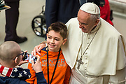 A boy take a selfie with Popr Francis during his weekly general audience at the Paul VI hall on January 10, 2018 at the Vatican.