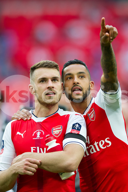 Theo Walcott of Arsenal and Aaron Ramsey of Arsenal during the Emirates FA Cup Final between Arsenal and Chelsea at Wembley Stadium, London, England on the 27th May 2017. Photo by Salvio Calabrese.