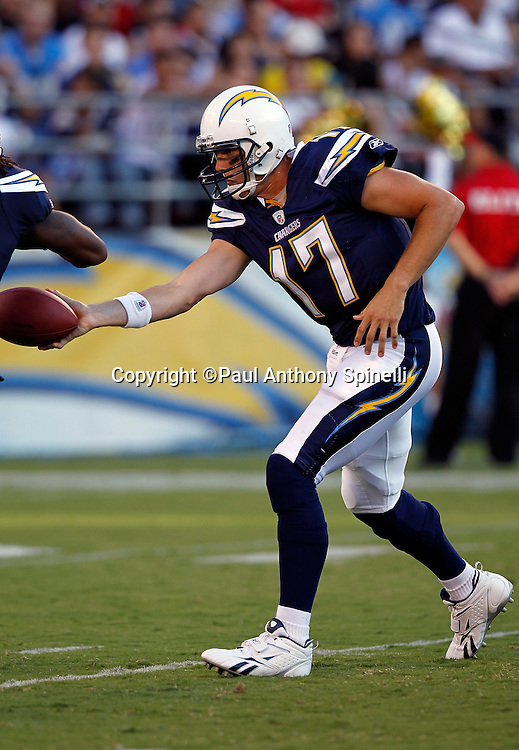 San Diego Chargers quarterback Philip Rivers (17) hands off the ball on a running play during a NFL week 2 preseason football game against the Dallas Cowboys on Saturday, August 21, 2010 in San Diego, California. The Cowboys won the game 16-14. (©Paul Anthony Spinelli)
