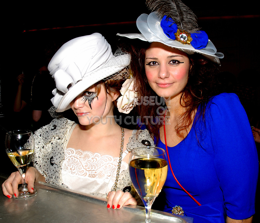 Two glamourous girls dressed up, Anti-Social, London December 2006