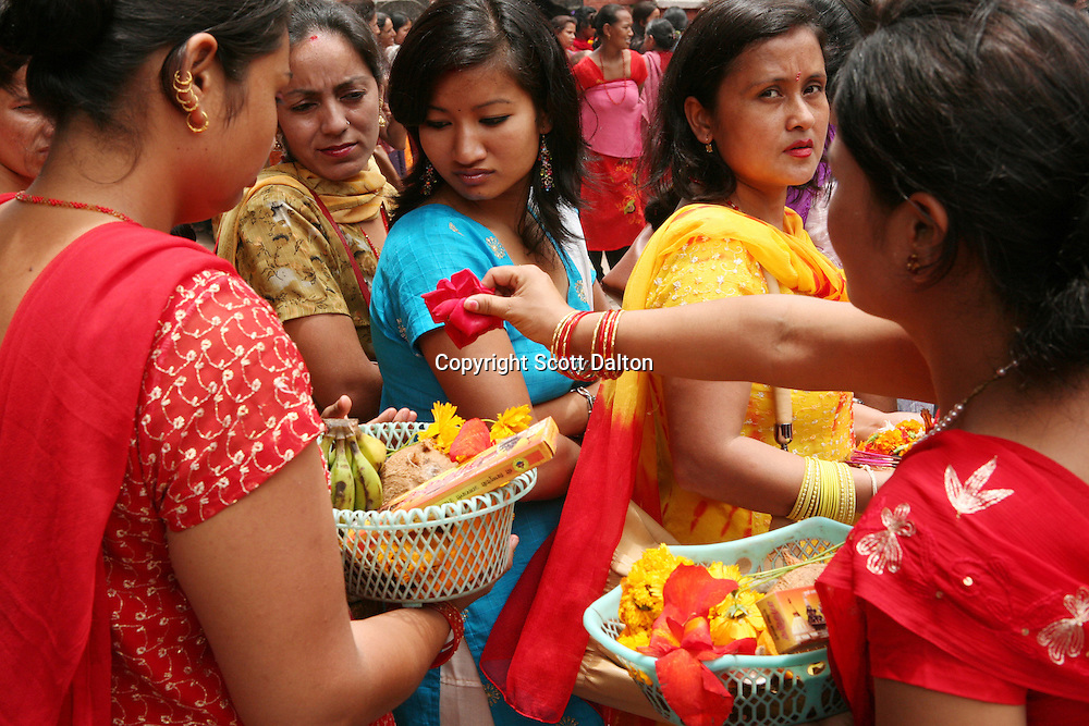 Devout Hindus wait to leave offerings and pray at a temple in Patan, the sister city to Kathmandu, Nepal on June 8, 2006. Nepal is a popular tourist destination despite the ten-year old conflict that has claimed an estimated 13,000 lives. (Photo/Scott Dalton)