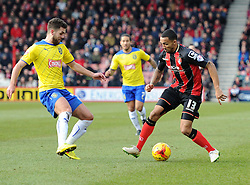 Bournemouth's Callum Wilson in action against Huddersfield Town's Tommy Smith - Photo mandatory by-line: Paul Knight/JMP - Mobile: 07966 386802 - 14/02/2015 - SPORT - Football - Bournemouth - Goldsands Stadium - AFC Bournemouth v Huddersfield Town - Sky Bet Championship